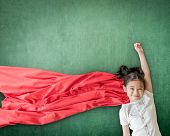 Superhero Asian School Girl Kid Student With Inspiration In Women Rights In Education Success Concep poster
