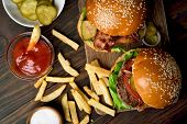 Tasty Burger And French Fries On Wooden Table. Top View, Flat Lay poster