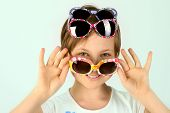 Close-up Portrait Of A Little Girl Wearing Funky Sunglasses. Young Teenage Girl Wearing Stylish Sung poster