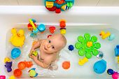Baby Boy Taking A Bath, Playing With Colorful Toys poster