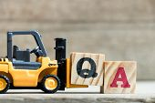Toy Yellow Forklift Hold Letter Block Q To Complete Word Qa (abbreviation Of Quality Assurance Or Fr poster