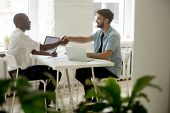 Black And White Entrepreneurs Shaking Hands Sitting At Office Desk, Satisfied Multi-ethnic Casual Bu poster