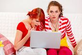 Two Girlfriends Amazed The Seen In A Laptop