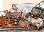 Fully Loaded Truck With Metal Scrap Metal Parts. Loading Scrap In Truck. poster