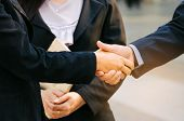 Deal. Team Business Man And Woman Handshake After Finishing Up New Project Plan Business Meeting In  poster