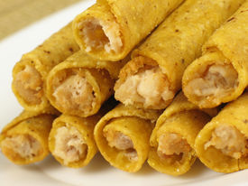 pic of flauta  - A plate of hot crispy chicken taquitos - JPG
