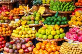 Tropical Fruits On The Famous Market In Funchal, Madeira Island, Portugal. Exotic Fruit. Banana, Man poster