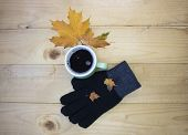 Autumn Still Life. Cup Of Tea With Maple Autumn Leaves And Gloves On A White Background. Autumn Seas poster
