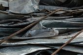 Twisted Metal Sheets. A Pile Of Rusty Iron. Sheets Of Roofing Iron. Iron Sheets After Home Renovatio poster