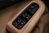 Close Up Of A Door Control Panel In A New Modern Car. Arm Rest With Window Control Panel With Leathe poster