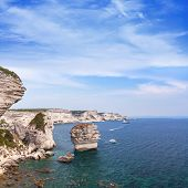 Coastal Rocks Of Bonifacio. Coastal Landscape Of Corsica Island At Summer Day, France. Square Backgr poster