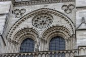 Paris, France, December 16, 2017. Front Facade Of Cathedral Of Notre Dame De Paris, With Square Full poster