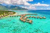 Travel vacation Tahiti hotel ocean beach paradise of overwater bungalows resort in coral reef lagoon poster