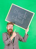 Apply For Sensational Educational Offer. Man Bearded Teacher Holds Blackboard Back To School Inscrip poster