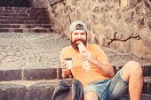 Hungry Man Snack. Junk Food. Guy Eating Hot Dog. Man Bearded Enjoy Quick Snack And Drink Paper Cup.  poster