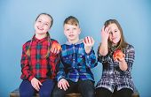 Healthy Lifestyle. Group Teenagers Hold Apples. Boy And Girls Friends In Similar Checkered Clothes E poster