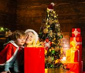 Cozy Evening At Home. Family Having Fun At Home Christmas Tree. Happy Family. Family Holiday. Mom An poster