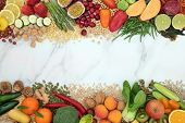 Vegan health food background border with a large collection of foods. High in protein, vitamins, min poster