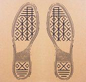 Imprint Soles Of Sneakers On Cardboard Sheet. Imprint Soles Shoes - Sneakers On Cardboard Background poster
