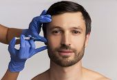Male Injective Cosmetology. Middle Aged Man Receiving Wrinkle-removing Injection Over White Studio B poster