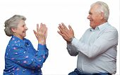Seventy Year Old Couple Clap One`s Hands