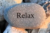 foto of stressless  - Positive reinforcement word Relax engrained in a rock - JPG