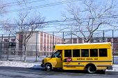 School bus in front of public school in Brooklyn, NY