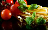 stock photo of italian food  - ingredients for tasty italian pasta with tomato - JPG