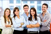 stock photo of cross  - Happy business team with arms crossed at the office - JPG