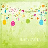 Hanging Easter eggs, flowers, butterflies and colorful dots on green textured background forming a h