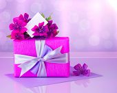 Picture of pink gift box with purple silk ribbon, beautiful violet wild flowers bouquet, white blank