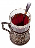 picture of melchior  - black tea in vintage glass with teaspoon isolated on white background - JPG