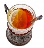 foto of melchior  - top view of black tea with lemon in vintage glass with spoon isolated on white background - JPG
