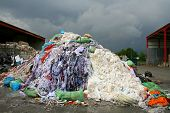 foto of waste disposal  - waste material on a stormy background in Germany - JPG