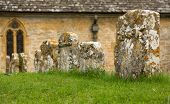 picture of slaughter  - St Peters parish church in Upper Slaughter in Cotswold or Cotswolds district of southern England in the autumn - JPG