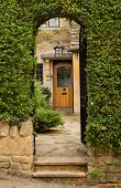 stock photo of english cottage garden  - Entrance to front door of cottage in Stanton in Cotswold or Cotswolds district of southern England in the autumn - JPG