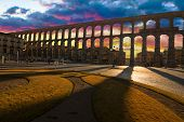 stock photo of aqueduct  - Ancient Aqueduct in Segovia Spain. A historic european landmark.