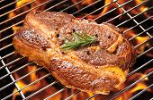 foto of ribeye steak  - Grilled beef steak on the flaming grill - JPG