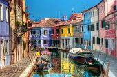 stock photo of old boat  - Colorful houses and canal on Burano island - JPG