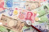 foto of japanese coin  - asian currency stethoscope and Background of asian currency  - JPG
