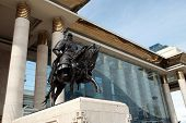 stock photo of ulaanbaatar  - A statue of Ghengis Kahn adorns the front stoop of the parliament building in Ulaanbaatar - JPG