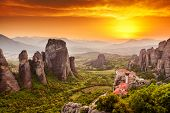 stock photo of unique landscape  - Meteora Roussanou Monastery at sunset Greece - JPG