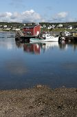 stock photo of lobster boat  - Lobster boat reflection in the harbour on a summer morning located in Nova Scotia Canada - JPG