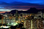 picture of mountain lion  - Kowloon cityscape in Kong Kong with lion rock mountain - JPG