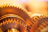 stock photo of interlocking  - golden gear wheels - JPG