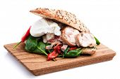 Club Sandwich with with chicken and poached egg
