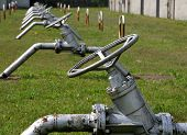 stock photo of gases  - huge series valves control the flow of gases and flammable liquids in pipes