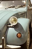 Постер, плакат: The front of an old car Citroen 2CV
