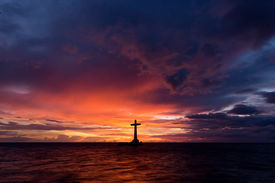 picture of camiguin  - Catholic cross silhouette in a sunken cemetery at dusk - JPG