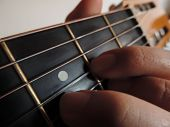 stock photo of fret  - NOTE D MAJOR ACOUSTIC GUITAR BLACK FRETS - JPG